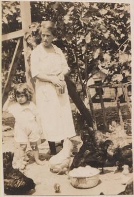 Sadie and Margaret feeding chickens